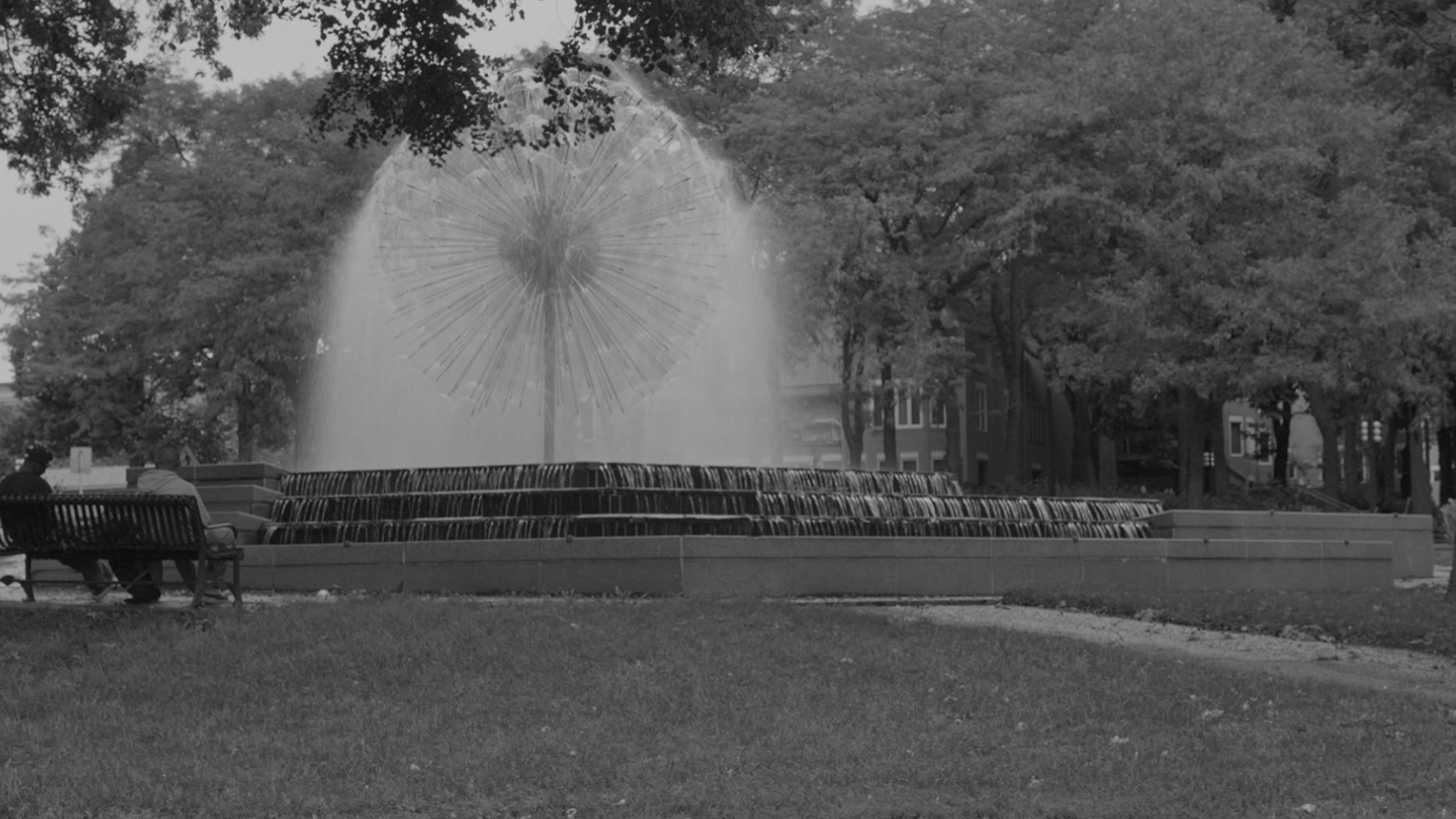stylized, B&W photo of DUNWOODY COLLEGE OF TECHNOLOGY, LORING PARK DANDELION FOUNTAIN ENCLOSURE