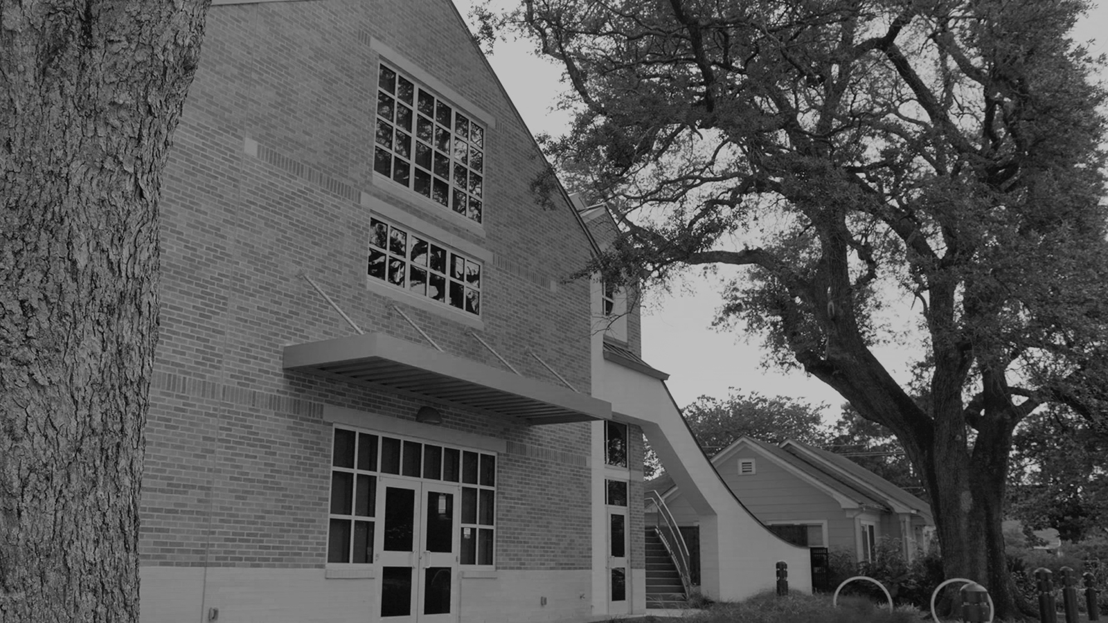 stylized, B&W photo of TRACY DESIGN STUDIO - WEST UNIVERSITY BAPTIST CHURCH YOUTH MINISTRY BUILDING